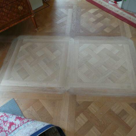 schadeherstel aan patroonvloer in Amsterdam door Vloerenhuis